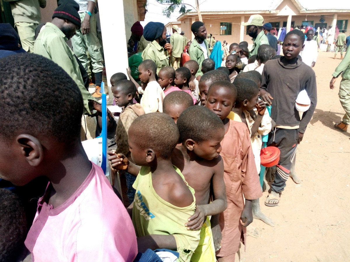 Amajiri Kids queuing to be shaved during our outreach in Augie